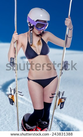 Freeride naked girl with snow landscape at background - stock photo
