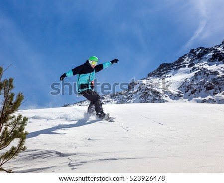 Freerider snowboarder moving down in snow powder