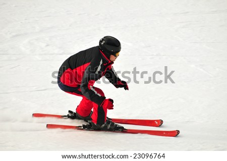 Freeriding skier on the mountain side - stock photo