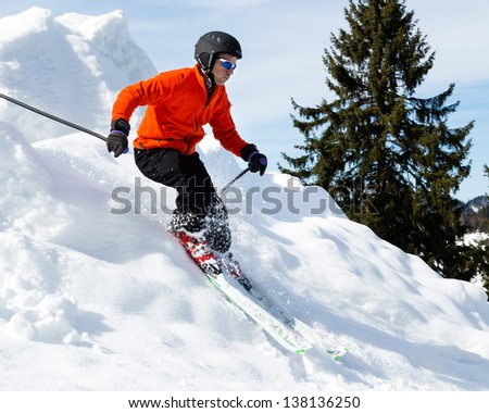 freeskier in a downhill - stock photo