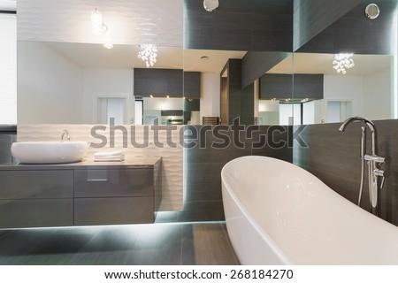 Freestanding bathtub in stunning modern bathroom design - stock photo