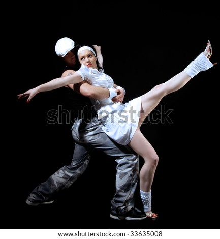 freestyle dancing couple on black