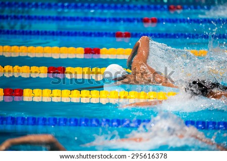 freestyle men swimming race in swimming pool - stock photo