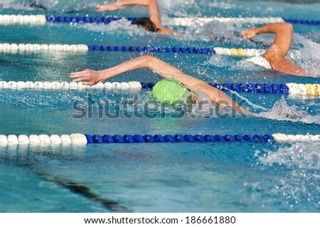 Freestyle swimmers in a close race