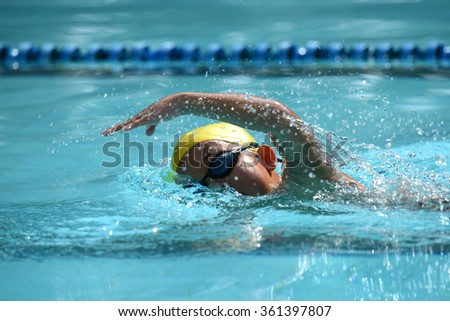 Freestyle swimming stroke of Kid swimmer on pool in race