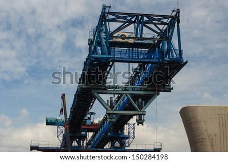 Freeway construction crane - stock photo