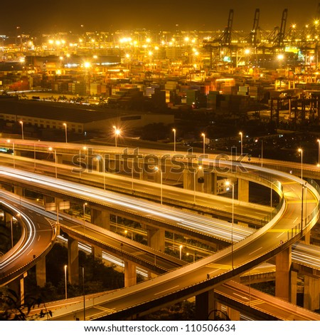 Freeway in night with cars light in modern city - stock photo