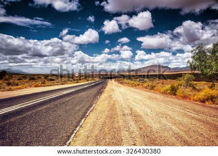 Freeway in the wild area, autobahn in countryside, sign of speed limit, road trip travel in South Africa - stock photo