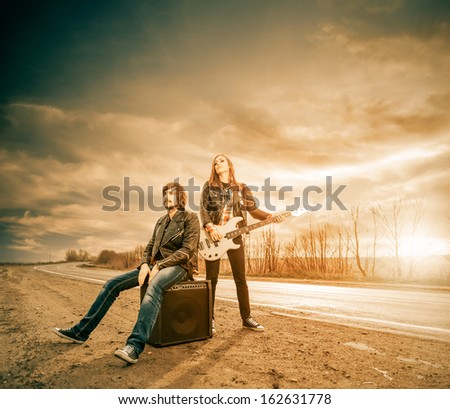 freeway music players at roadside sunset - stock photo