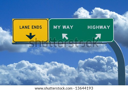 Freeway sign in blue cloudy skies reading My Way or The Highway - stock photo