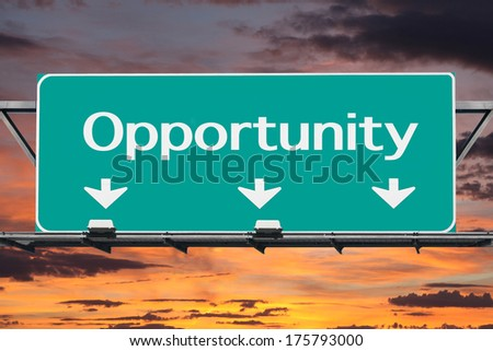 Freeway to opportunity road sign with sunrise sign. - stock photo