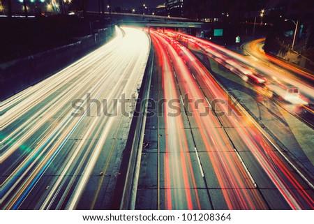 Freeway Traffic at Sunset - stock photo