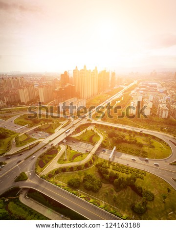 Freeway  with cars  in modern city. - stock photo