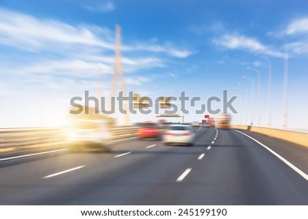 freeway with sky background. - stock photo