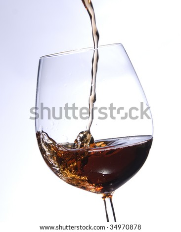 Freeze frame of dessert wine being poured into a glass