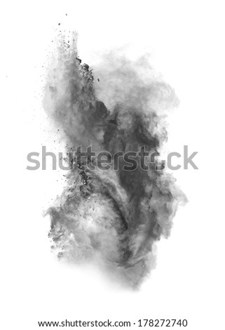 Freeze motion of black dust explosion isolated on white background - stock photo