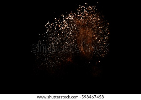 Freeze motion of color powder coming down on black background,Abstract design of falling dust cloud,artificial snow fall concept.