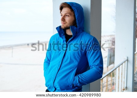 Freezed man in blue hoodie. - stock photo