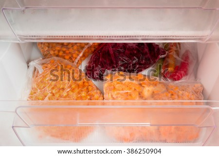 freezer with vegetables and berries
