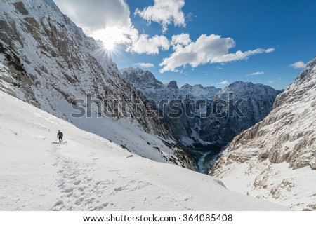 Freezing winter condition in the mountains. Serene scene from Julian Alps