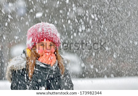 freezing young woman warming his hands - stock photo