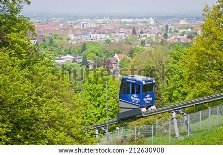 FREIBURG, GERMANY - MAY 5, 2013: The Schlossbergbahn (English: Castle Hill Railway) is a funicular railway in Freiburg im Breisgau city, Germany. It links the city centre with the Schlossberg hill - stock photo
