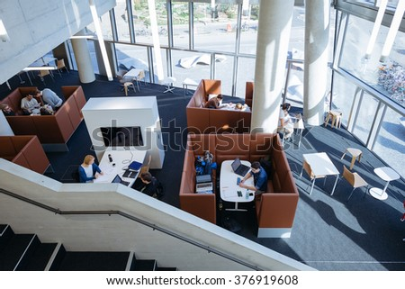 FREIBURG, GERMANY - OCTOBER, 2015: Images of the interior and surroundings of the newly built University Library in Freiburg in 10/15. Images show modern concrete architecture and people. - stock photo