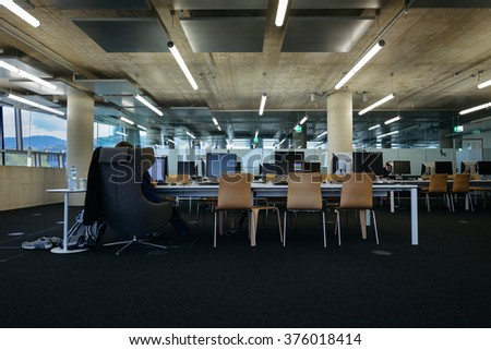 FREIBURG, GERMANY - OCTOBER: Images of the interior of the newly built University Library in Freiburg, Germany in 10/15. Images show modern concrete architecture and designer furniture with students.
