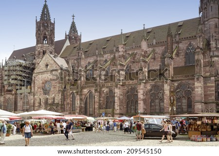 FREIBURG IM BREISGAU, GERMANY - AUGUST 6, 2014: Weekly market near the Minster in Freiburg, a city in the south-western part of Germany in the Baden-Wurttemberg state.