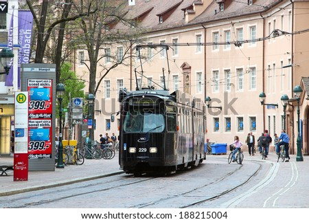 FREIBURG IM BREISGAU, GERMANY - May 05, 2013: Tram in downtown Freiburg. Special additional trams run in the day of football game to carry fans to the stadium - stock photo