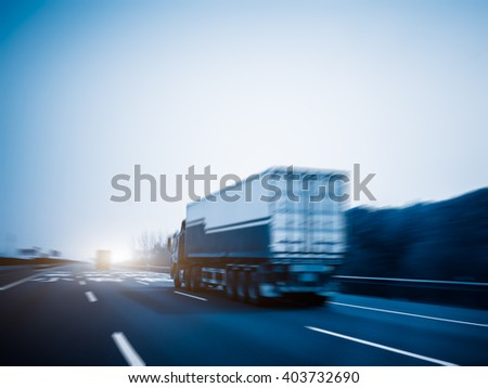 freight car driving on the highway,motion blurred - stock photo