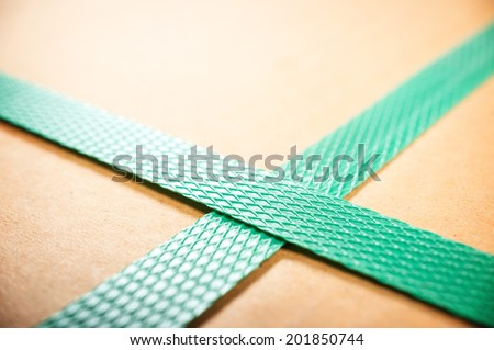 freight parcel with plastic strap background - stock photo