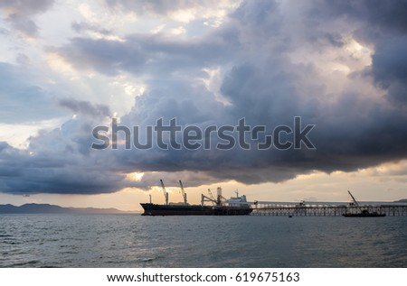 Freight ship loading goods in the harbour