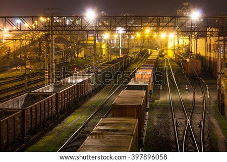 Freight Station with trains at night - stock photo