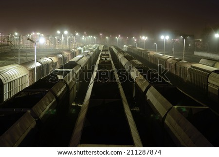 Freight Station with trains, cargo transportation at night - stock photo