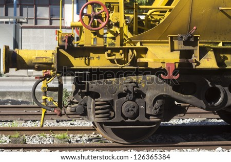 Freight train valve and wheel close-up - stock photo
