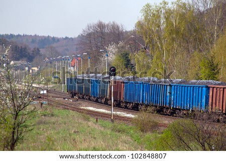 Freight train with coal on the station