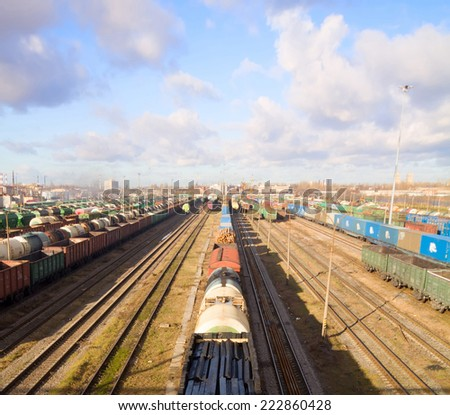 Freight train with color cargo containers in depot - stock photo
