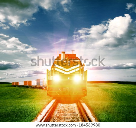 freight train with headlights - stock photo