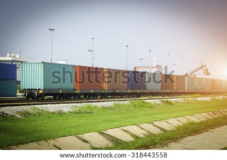 Freight trains at sunset - transport  - stock photo