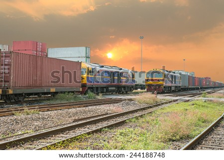 Freight trains on cargo terminal at dusk - stock photo