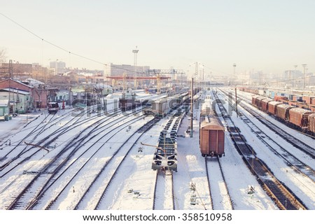 Freight trains under snow on winter cargo terminal