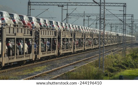 Freight trains with cars - stock photo