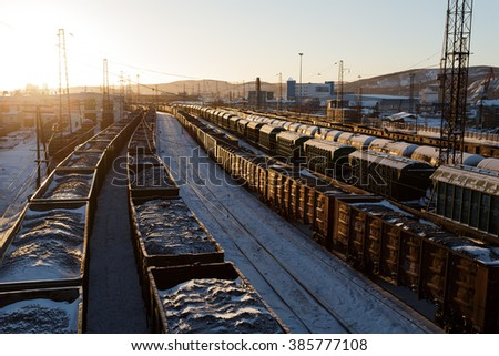 Freight trains with coal in the rays of the sun in Murmansk - stock photo