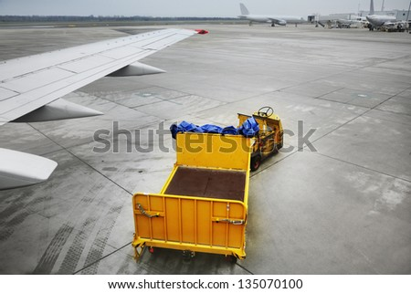 Freight trolleys on the runway - stock photo