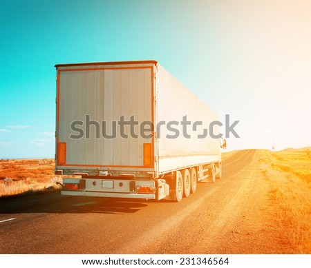 freight truck driving to sunset