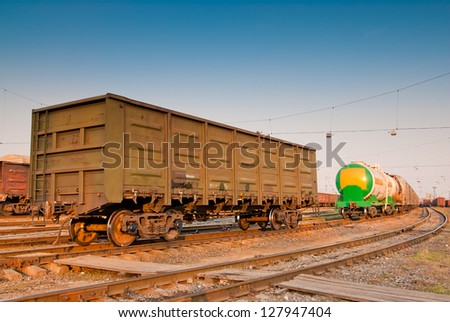 freight wagon on railroad tracks - stock photo