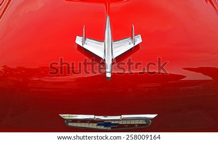 FREISING, GERMANY - AUGUST 1, 2014 Shiny red vintage Chevrolet car hood with airplane logo - stock photo