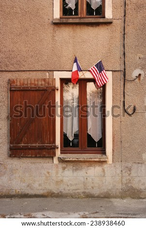 French and American flags at a house near Utah Beach, Normandy, France  - stock photo