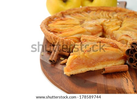 French apple tart on a white background - stock photo